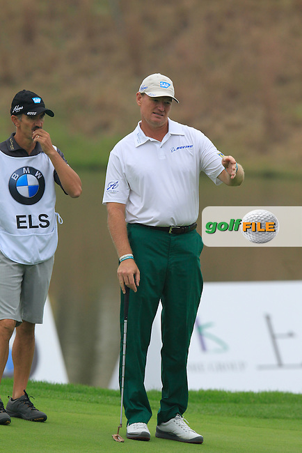 Ernie Els (RSA) and caddy Colin Byrne on the 18th green during Saturay's Round 3 of the 2014 BMW Masters held at Lake Malaren, Shanghai, China. 1st November 2014.<br /> Picture: Eoin Clarke www.golffile.ie