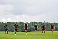 Bath players look on. Bath Rugby pre-season training on July 8, 2014 at Farleigh House in Bath, England. Photo by: Patrick Khachfe/Onside Images