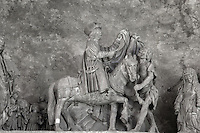 A bishop on horseback flanked by 2 women, by Pierre Legros, 1683, 'Virgin panel' from the choir screen, Chartres Cathedral, Eure-et-Loir, France. Chartres cathedral was built 1194-1250 and is a fine example of Gothic architecture. It was declared a UNESCO World Heritage Site in 1979. Picture by Manuel Cohen.