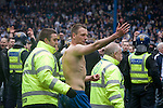 Crystal Palace defender Clint Hill is escorted from the pitch by stewards at Hillsborough after the final whistle of the crucial last-day relegation match against Sheffield Wednesday. The match ended in a 2-2 draw which meant Wednesday were relegated to League 1. Crystal Palace remained in the Championship despite having been deducted 10 points for entering administration during the season.