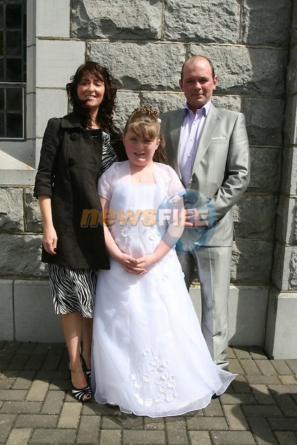 Amy O'Reilly at her Communion in Duleek Church with Louise O'Reilly and Alan Loughran...Photo NEWSFILE/Jenny Matthews.(Photo credit should read Jenny Matthews/NEWSFILE)....This Picture has been sent you under the condtions enclosed by:.Newsfile Ltd..The Studio,.Millmount Abbey,.Drogheda,.Co Meath..Ireland..Tel: +353(0)41-9871240.Fax: +353(0)41-9871260.GSM: +353(0)86-2500958.email: pictures@newsfile.ie.www.newsfile.ie.FTP: 193.120.102.198.