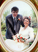 COPY BY TOM BEDFORD<br />Pictured: Undated collect picture of Howard and Carole Denby's wedding<br />Re: Carmarthenshire Coroner's Inquest into the death of 63 year old Carole Denby, who died after an agonising eight years living with a rogue piece of metal in her leg.<br />Denby from Llanelli, Wales, was only proved right that there was a piece of metal in her ankle after she was cremated.<br />She had broken her left ankle in 2006, but attempts to repair it were unsuccessful after numerous operations.<br />Her widower, Howard, is demanding answers as to how his wife's medics had failed to find a two-inch titanium surgical screw, which he believes led to his wife's continuing and unbearable agony , and eventually, he says, her death.