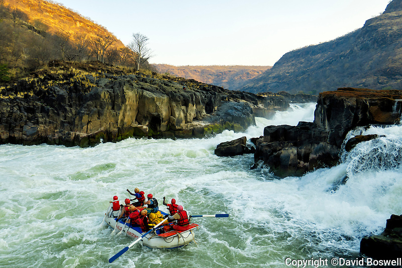 A raft puts in below Lower Moemba Falls after the mandatory portage on the Zambezi River in East Africa.