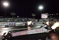 Oct. 26, 2012; Las Vegas, NV, USA: NHRA top fuel dragster driver Antron Brown (near lane) races alongside Shawn Langdon during qualifying for the Big O Tires Nationals at The Strip in Las Vegas. Mandatory Credit: Mark J. Rebilas-