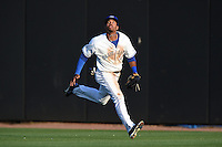 Dunedin Blue Jays  outfielder Dalton Pompey (23) chases down a fly ball during a game against the Brevard County Manatees on April 11, 2014 at Florida Auto Exchange Stadium in Dunedin, Florida.  Brevard County defeated Dunedin 5-2.  (Mike Janes/Four Seam Images)