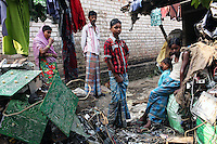 Villagers stand among piles of e-waste in the village of Sangrampur, located south of Kolkata in northeast India. Globally, an estimated 50 million tons of e-waste are produced annually, and much of it ends up in countries like India. November, 2013
