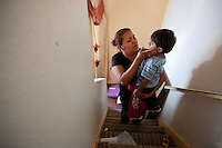 leaving0627 Marlen Ramirez, consoles her son Christian Sanchez, 2, while preparing to move to Pennsylvania.  (Pat Shannahan/ The Arizona Republic)