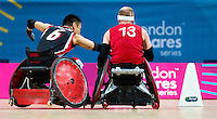 18 APR 2012 - LONDON, GBR - Great Britain's Aaron Phipps (GBR) (Class 3.5) (right) races for the goal line pursued by Canadian Ian Chan (CAN) (Class 3.0) (left) during their London International Invitational Wheelchair Rugby Tournament match at the Olympic Park Basketball Arena in Stratford, London, Great Britain .(PHOTO (C) 2012 NIGEL FARROW)
