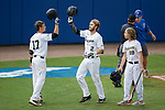 Johnny Aiello (2) of the Wake Forest Demon Deacons bangs helmets with teammate Bruce Steel (17) after hitting a solo home run against the Florida Gators in Game Two of the Gainesville Super Regional of the 2017 College World Series at Alfred McKethan Stadium at Perry Field on June 11, 2017 in Gainesville, Florida.  (Brian Westerholt/Four Seam Images)