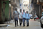 Refugee children walk to school through a neighborhood of Cairo, Egypt. They attend a school operated by St. Andrew's Refugee Services that is supported by Church World Service.