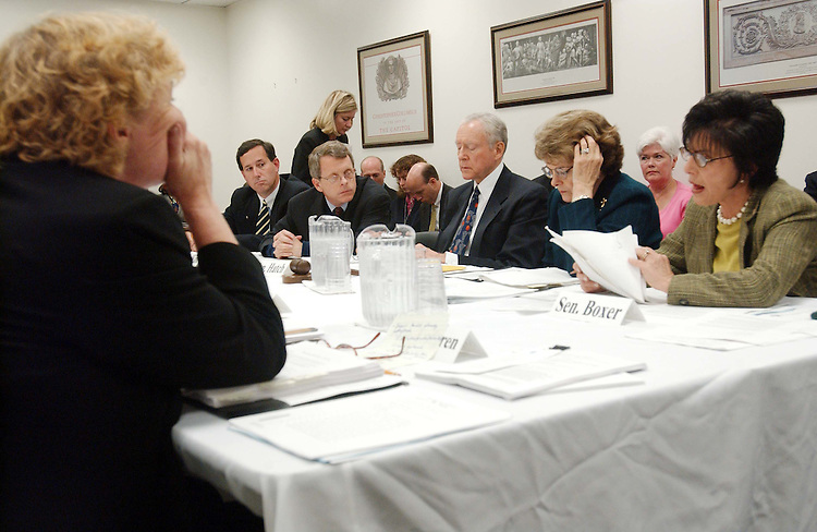 """9/30/03.'PARTIAL-BIRTH' ABORTION CONFERENCE COMMITTEE--.House and Senate conferees meet to consider legislation that would prohibit the procedure commonly known as partial-birth abortion, the """"Partial-Birth Abortion Ban Act of 2003."""" At left is Rep. Zoe Lofgren, D-Calif., and at right is Sen. Barbara Boxer, D-Calif. Sen. Rick Santorum, R-Pa., Sen. Mike DeWine, R-Ohio, Senate Judiciary Orrin G. Hatch, R-Utah, and Sen. Dianne Feinstein, D-Calif., look on..CONGRESSIONAL QUARTERLY PHOTO BY SCOTT J. FERRELL"""