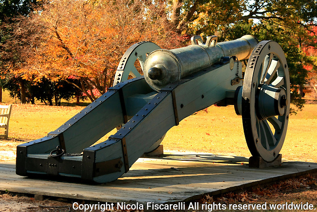 A close-up of a revolutionary war cannon on the Yorktown Battlefield .