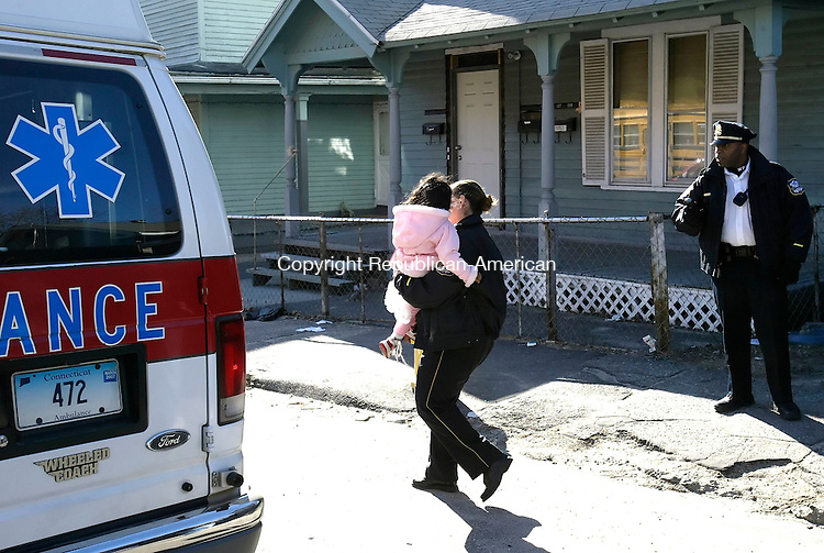 WATERBURY, CT. 09 FEBRUARY 2006-020906BZ03- Waterbury Police remove a little girl from 588 Baldwin St. Thursday afternoon after the untimely death of an infant was reported.  <br /> Jamison C. Bazinet / Republican-American