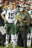 New York Jets quarterback Josh McCown (15) discusses strategy with offensive coordinator/quarterbacks Jeremy Bates during the second quarter against the Washington Redskins at FedEx Field in Landover, Maryland on Thursday, August 16, 2018.  The Redskins won the game 15 - 13.<br /> Credit: Ron Sachs / CNP<br /> (RESTRICTION: NO New York or New Jersey Newspapers or newspapers within a 75 mile radius of New York City)