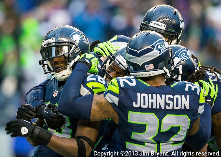 Seattle Seahawks  cornerback Walter Thurmond ,left,  celebrates his   pass interception for a touchdown against the Minnesota Vikings with the defensive unit) at CenturyLink Field in Seattle, Washington on  November 17, 2013.  The Seahawks beat the Vikings 41-20.  ©2013.  Jim Bryant. All Rights Reserved