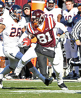 Nov 27, 2010; Charlottesville, VA, USA;  Virginia Tech Hokies wide receiver Jarrett Boykin (81) runs past Virginia Cavaliers linebacker Ausar Walcott (26) during the game at Lane Stadium. Virginia Tech won 37-7. Mandatory Credit: Andrew Shurtleff