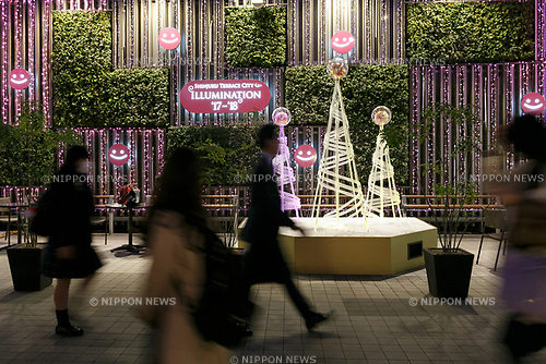 Pedestrians walk past the illuminations at Shinjuku Terrace City on November 16, 2017, Tokyo, Japan. Shinjuku Terrace City Illuminations are seen around Odakyu Line Shinjuku Station. This year marks the 12th year of the illumination event, which can be enjoyed until February 22, 2018. (Photo by Rodrigo Reyes Marin/AFLO)