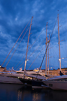 Large yachts moored in harbour at dusk, Saint Tropez, France