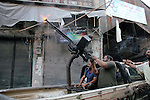 Free Syrian Army fires an anti-aircraft heavy machine gun at an army MiG-23 conducting raids on the in the old city of Aleppo on September 19. 2012. Photo by Ahmed Deeb