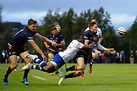 Henry Pyrgos of Edinburgh Rugby offloads the ball after being tackled by Semesa Rokoduguni of Bath Rugby. Pre-season friendly match, between Edinburgh Rugby and Bath Rugby on August 17, 2018 at Meggetland Sports Complex in Edinburgh, Scotland. Photo by: Patrick Khachfe / Onside Images