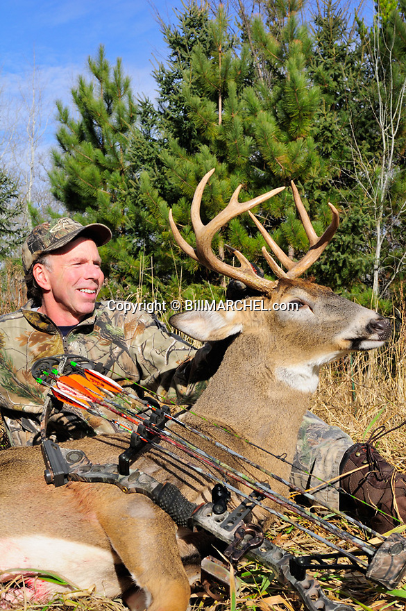 00273-044.18 White-tailed Deer Hunting: Archer poses with nine point buck taken.  Mathews bow.  Pope & Young score 115.