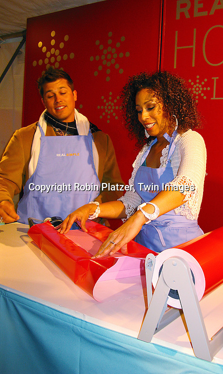 Andy Phillips and Tamara Tunie wrapping a gift.at The Miracle on Madison Avenue event on December 2, 2007 on Madison benefitting The Children's Aid Society in New York City. .Robin Platzer, Twin Images..212-935-0770