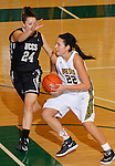 SPEARFISH, SD - FEBRUARY 22, 2014:  Chelsey Biegler #22 of Black Hills State drives past Jeri Pikul #24 of UC-Colorado Springs during their Rocky Mountain Athletic Conference game Saturday at the Donald E. Young Center in Spearfish, S.D.  (Photo by Dick Carlson/Inertia)