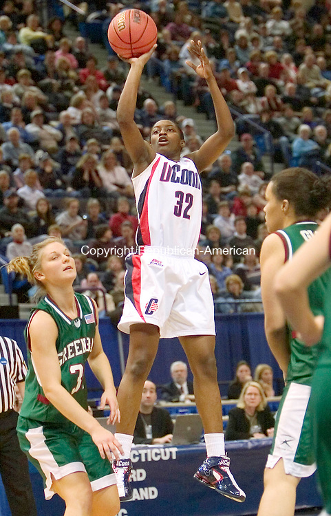 HARTFORD, CT. 20 March 2007-032007SV04--#32 Kalana Greene of UConn puts up a shot over #3o Rachel Porath of Wisconsin Green Bay during the second round of NCAA action at the Civic Center in Hartford Tuesday.<br /> Steven Valenti Republican-American