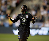 Eddie Johnson (9) of the MLS All-Stars celebrates his game-winning goal during the game at PPL Park in Chester, PA.  The MLS All-Stars defeated Chelsea, 3-2.