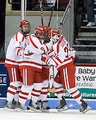 Max Nicastro (BU - 7), Joe Pereira (BU - 6), Colby Cohen (BU - 25) and Ross Gaudet (BU - 22) celebrate Gaudet's goal. - The Boston University Terriers defeated the Merrimack College Warriors 6-4 (EN) on Saturday, January 16, 2010, at Agganis Arena in Boston, Massachusetts.