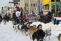 2010 Iditarod Ceremonial Start in Anchorage Alaska musher # 34 KIRK BARNUM with Iditarider MANNY CHAO