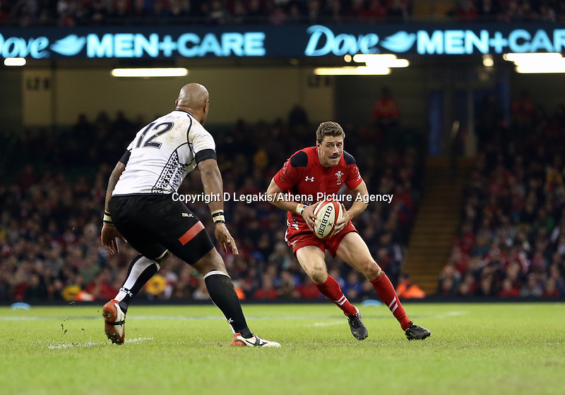 Pictured: Rhys Priestland of Wales (R) against Nemani Nadolo of Fiji (L). Saturday 15 November 2014<br />