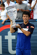 Washington, DC - August 9, 2015: Kei Nishikori of Japan poses with the trophy after winning the Citi Open ATP men's singles final against John Isner at the Rock Creek Park Tennis Center in Washington, DC  August 9, 2015.  (Photo by Elliott Brown/Media Images International)