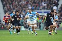 Javier Ortega Desio of Argentina on the attack as Mako Vunipola and Billy Vunipola of England give chase during the Old Mutual Wealth Series match between England and Argentina at Twickenham Stadium on Saturday 26th November 2016 (Photo by Rob Munro)