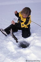 Ice fishing ling in winter