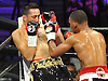 Sergio Mora, left, finds himself against the ropes as he battles Daniel Jacobs of Brooklyn during a Premier Boxing Champions match at the Barclays Center on Saturday, August 1, 2015. Jacobs won the bout by TKO in the second round. <br /> <br /> James Escher