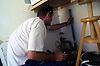 Plumber plumbing in washing machine in kitchen in north east England
