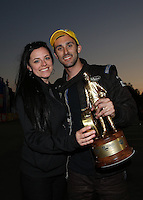 Feb. 17, 2013; Pomona, CA, USA; NHRA pro stock driver Vincent Nobile celebrates with Eileen Atkinson after winning the Winternationals at Auto Club Raceway at Pomona. Mandatory Credit: Mark J. Rebilas-