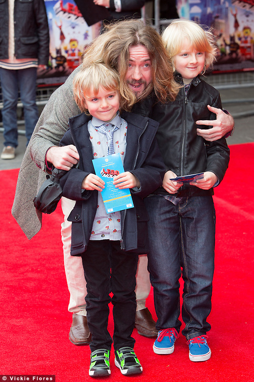 Justin Lee Colins and children attend the UK Premiere of The Lego Movie at the Vue West End in Leicester Square, London on February 9th, 2014.