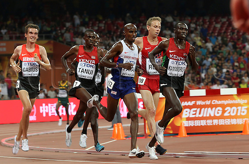22.08,2015. Beijing, China.   The later winner, Great Britain's Mohamed Farah (C) and other runners lap Germany's Arne Gabius (L) in the Men's 10,000 M Final at the 15th International Association of Athletics Federations (IAAF) Athletics World Championships at the National stadium, known as Bird's Nest, in Beijing, China, 22 August 2015.
