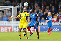 Curtis Nelson of Oxford United heads the ball under pressure from Anthony Grant of Peterborough United during the Sky Bet League 1 match between Peterborough and Oxford United at the ABAX Stadium, London Road, Peterborough, England on 30 September 2017. Photo by David Horn.