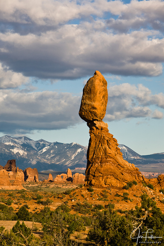 Balanced Rock in Arches National Park, Moab, Utah, USA with clouds near sunset.