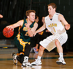 JANUARY 30, 2015 -- Tate Hilgenkamp #23 of Black Hills State drives toward Will Duggan #1 of Regis University during their Rocky Mountain Athletic Conference men's basketball game Friday evening at the Donald E. Young Center in Spearfish, S.D.  (Photo by Dick Carlson/Inertia)