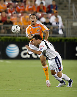 Houston Dynamo defender Patrick Ianni (4) goes up over the back of  CF Pachuca midfielder Christian Gimenez (19). CF Pachuca defeated Houston Dynamo 4-3 in penalty kicks after a 2-2 tie in regulation and extra time at Robertson Stadium in Houston, TX on August 14, 2007 in the SuperLiga semi-finals.