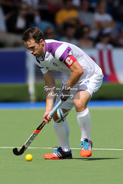 Chris Grassick (SCO) in action - Scotland v Wales. Hockey - Glasgow National Hockey Centre - Glasgow- PHOTO: Mandatory by-line: Paul Chesterton/SIPPA/Pinnacle - Tel: +44(0)1363 881025 - Mobile:0797 1270 681 - VAT Reg No: 183700120 - 280714 - Glasgow 2014 Commonwealth Games - Glasgow National Hockey Centre, Glasgow, Scotland, UK