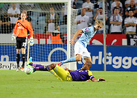 Thursday 08 August 2013<br /> Pictured: Ashley Williams of Swansea (on the ground) challenge against Pawel Cibicki of Malmo for which the former was shown a yellow card.<br /> Re: Malmo FF v Swansea City FC, UEFA Europa League 3rd Qualifying Round, Second Leg, at the Swedbank Stadium, Malmo, Sweden.