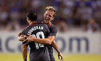 Landon Donovan #10 jumps is congratulated by Stuart Holden after scoring the winning goal against Honduras. USA clinches a spot in the  2010 World Cup after defeating Honduras in 3-1 during CONCACAF qualifying in San Pedro Sula, Honduras, October 10, 2009.