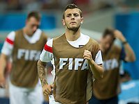 Jack Wilshere of England warms up along the sidelines