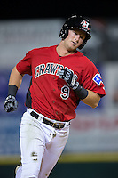 Tripp Martin (9) of the Hickory Crawdads rounds the bases after hitting a solo home run against the Kannapolis Intimidators at L.P. Frans Stadium on April 23, 2015 in Hickory, North Carolina.  The Crawdads defeated the Intimidators 3-2 in 10 innings.  (Brian Westerholt/Four Seam Images)
