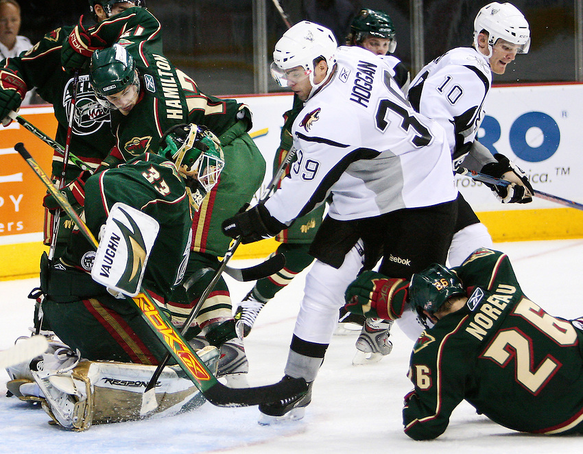 San Antonio's Jeff Hoggan rushes Houston goalie Barry Brust during the AHL game between the Houston Aeros and the San Antonio Rampage, Oct. 19, 2008, at the AT&T Center in San Antonio. (Darren Abate/pressphotointl.om)